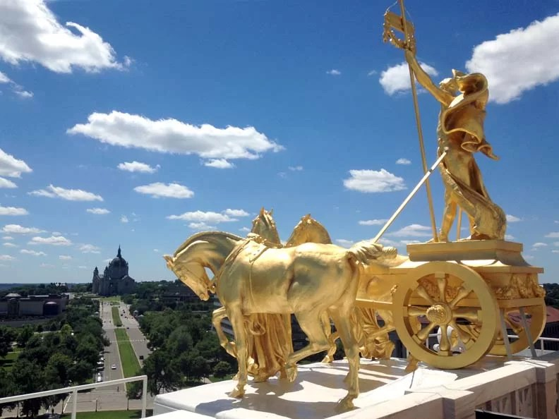 The tour guide let us up on the roof to see the gold chariot up close.