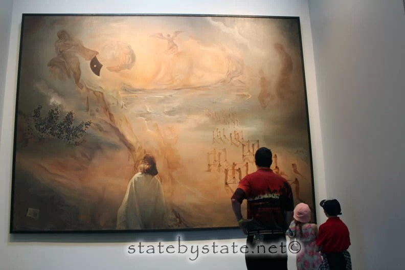 A family looking at a piece of art
