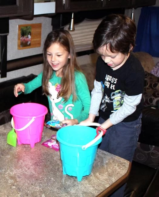 Two kids super happy to get sand buckets for Easter.