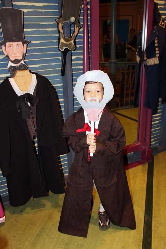 A little boy dressed up.