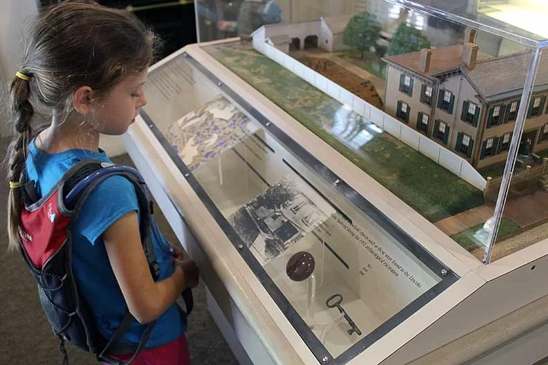 A girl reading a museum display.