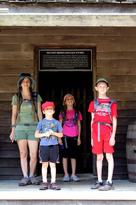 A family in front of a historic store.