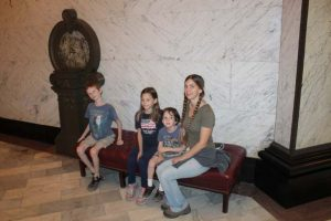 Sitting on a bench in the Jackson State Capitol