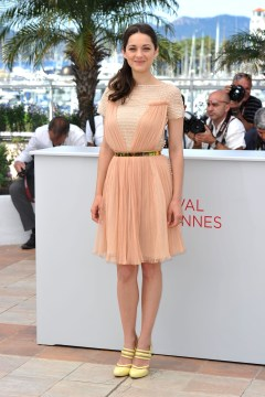"CANNES, FRANCE - MAY 17: Actress Marion Cotillard poses at the ""De Rouille et D'os"" Photocall during the 65th Annual Cannes Film Festival at Palais des Festivals on May 17, 2012 in Cannes, France. (Photo by Gareth Cattermole/Getty Images)"