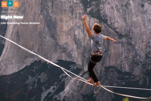 Balancing act by slacklining over a mountain cliff