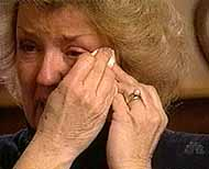 Juanita Broaddrick wipes a tear from her eye during her January 1999 interview on
