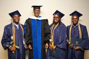 President Paul Kagame stands with Rwandan graduates for graduation 2012.