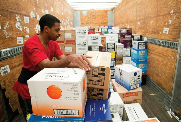 Employees at the North Carolina ABC Warehouse in Raleigh, N.C. load a truck with a shipment of spirits to be distributed to ABC stores in North Carolina on Thursday, August 18, 2016.