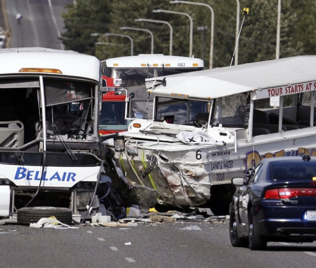 File Photo A Ride The Ducks Amphibious Tour Bus Right And A Charter Bus Remain At The Scene Of A Fatal Collision On The Aurora