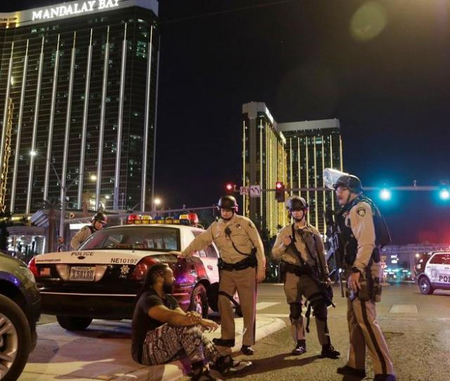 Police Officers Stand At The Scene Of A Shooting Near The Mandalay Bay Resort And Casino On The Las Vegas Strip Sunday Oct   In Las Vegas