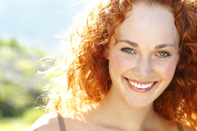 Woman with red hair outside