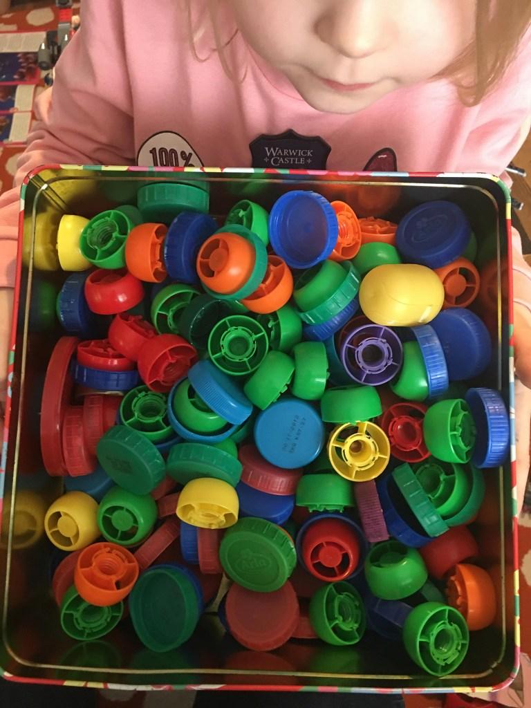 box of bottle tops