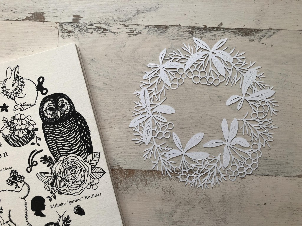 paper cutting book by garden
