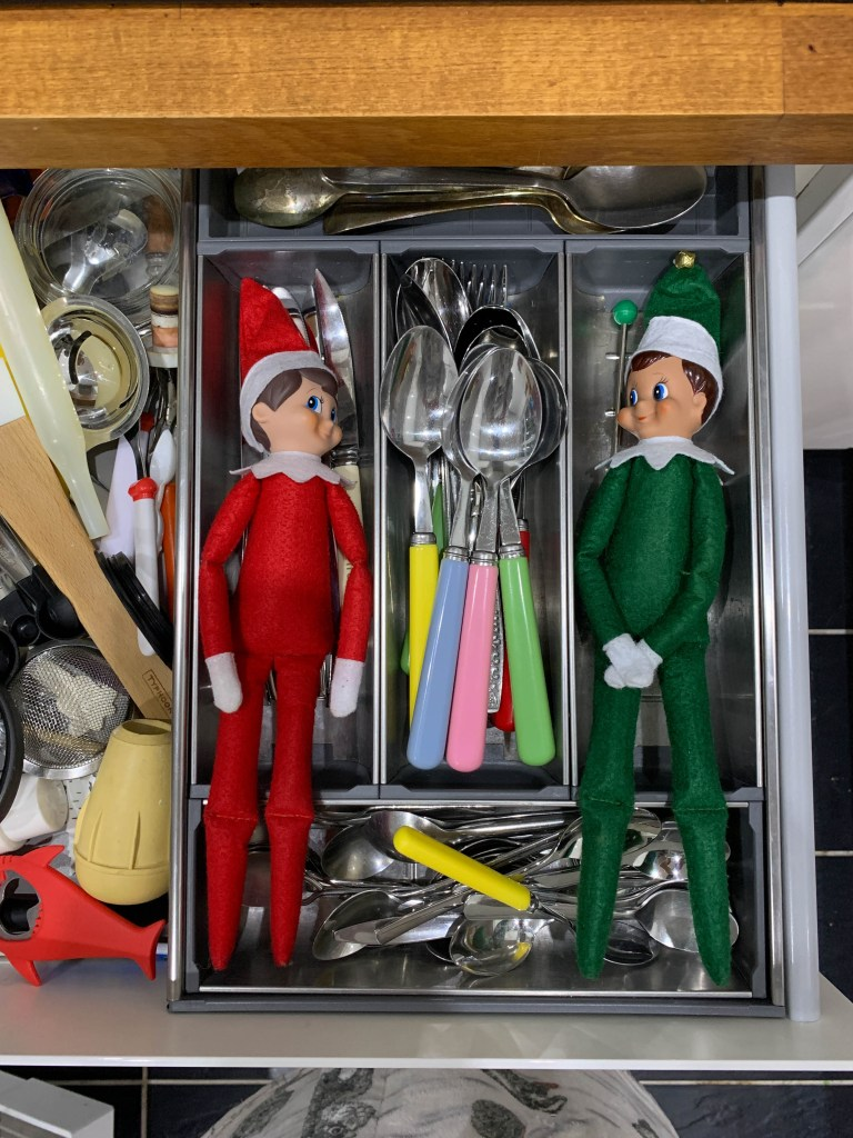 Elf on the Shelf hiding in the cutlery drawer