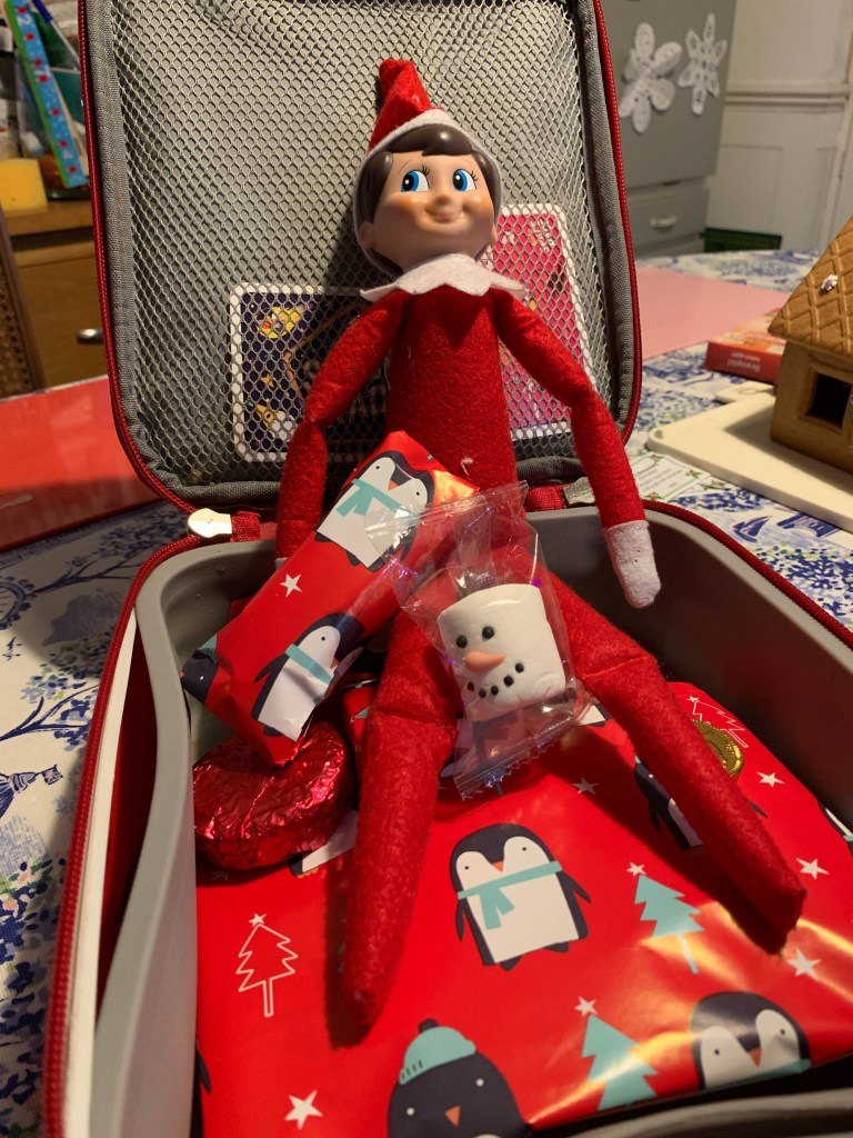 Elf on the Shelf wrapping up a packed lunch