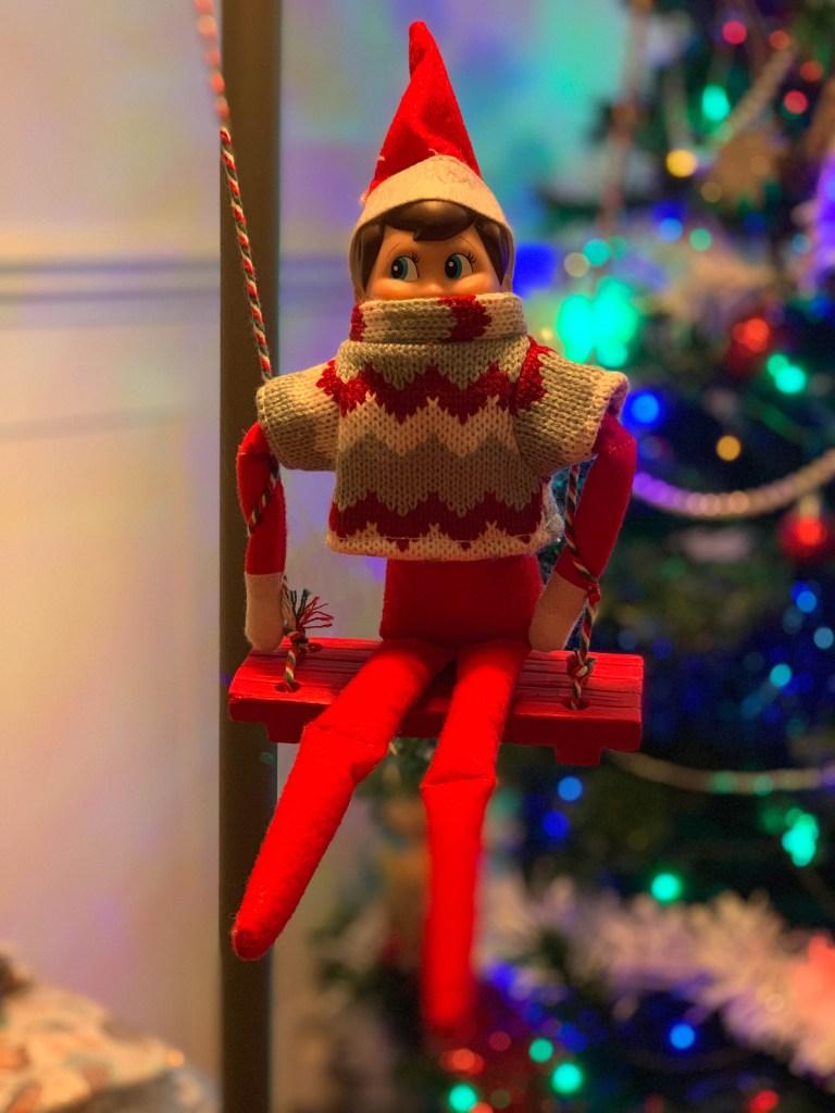 Elf on the Shelf on a swing