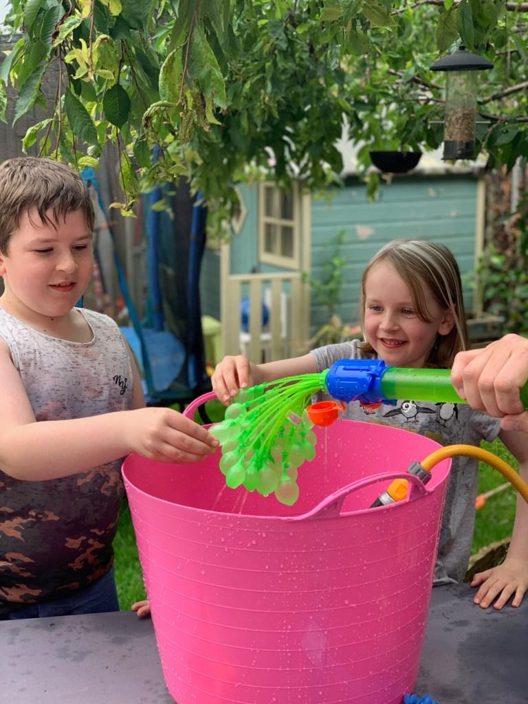 kids using the Bunch O Balloons Filler/Soaker