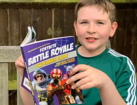 boy holding a Fortnite book