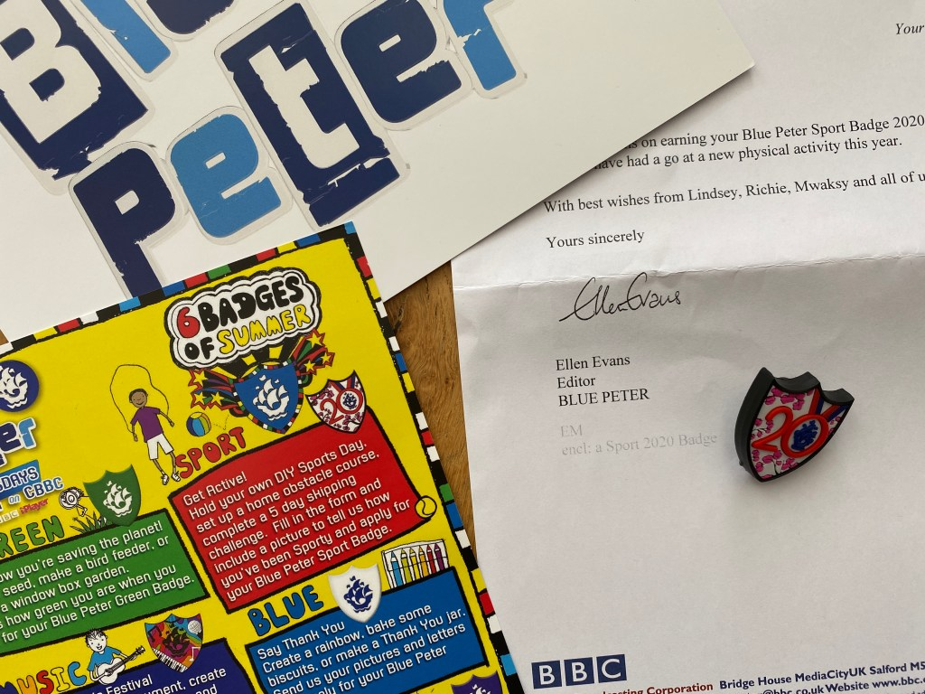what do I receive with my Blue Peter badge?
