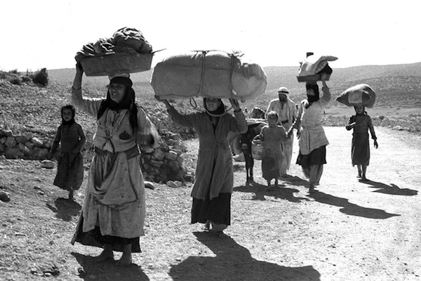 Palestinians flee from their village in the Galilee after it was conquered by Israeli forces during the 1948 war. (GPO)
