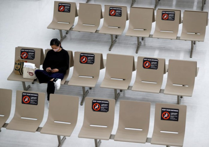 Signs for social distancing are seen on seats at the arrival zone of Narita airport, east of Tokyo, where there are fewer passengers than usual amid the coronavirus outbreak. (Reuters photo)
