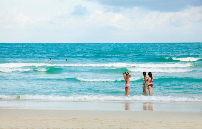 RELIEF FROM THE HEAT: Women prepare for a dip in the water on Koh Samui which has reopened to overseas visitors.