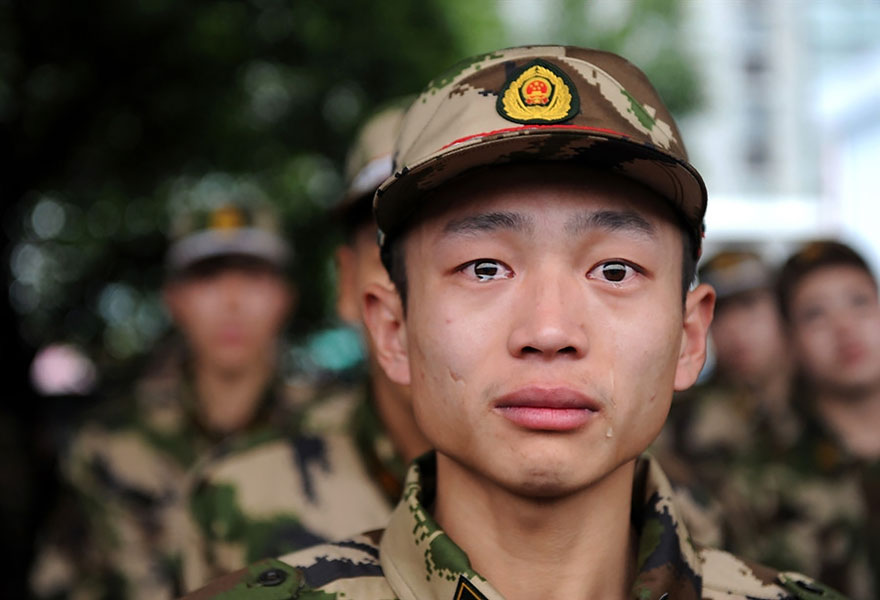 A Chinese Paramilitary Police Recruit Breaks Into Tears Before Shipping Off For Service