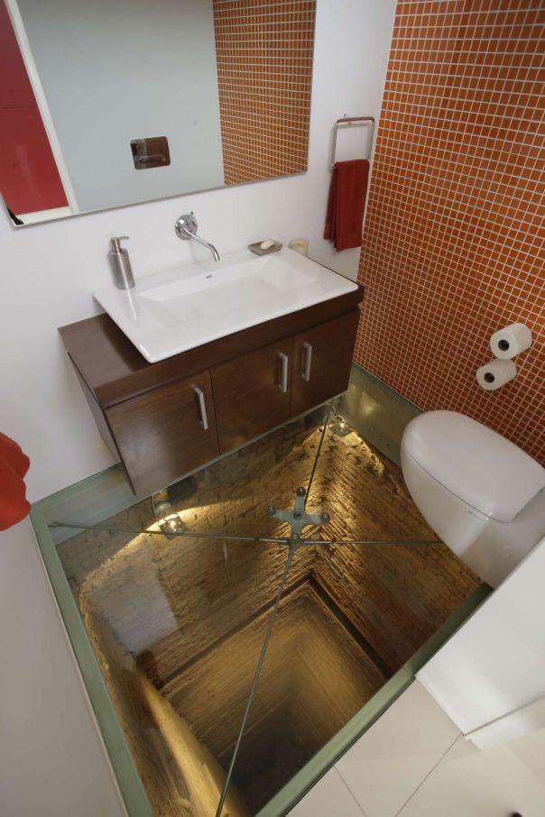 Glass Floor Over Open Shaft In Bathroom