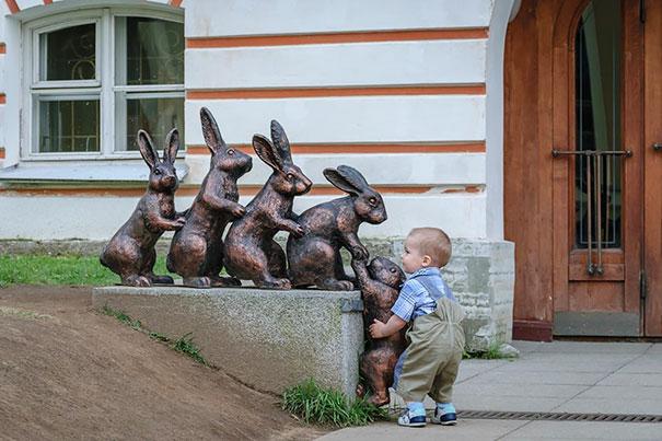 Kid Helps Bunny Climb Sculpture