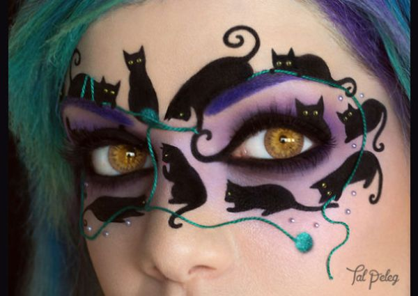 If one is not enough, try this black cat masquerade mask