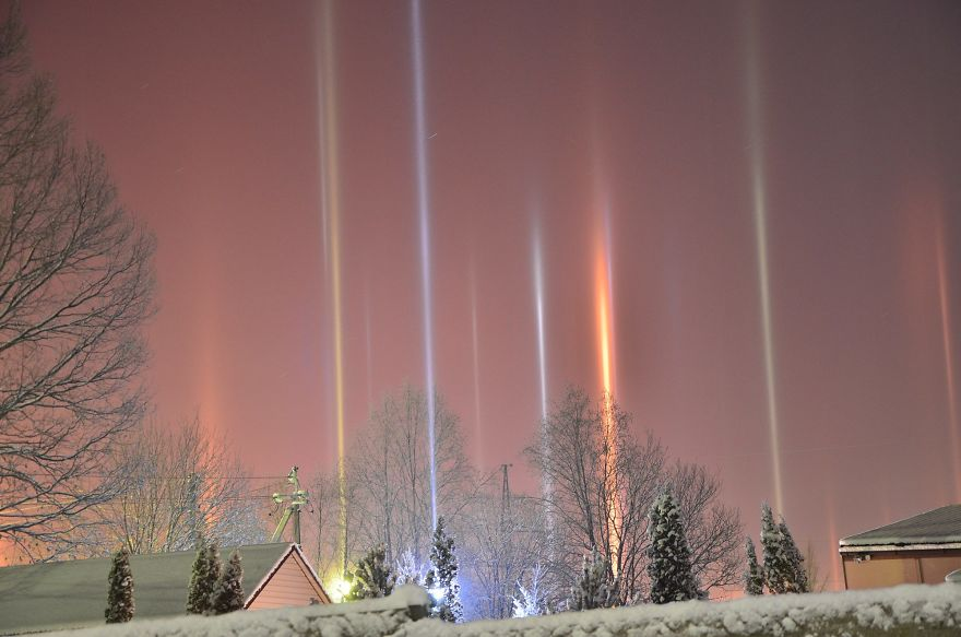 A light pillar is an atmospheric optical phenomenon, which is an interaction of light with ice crystals. When the temperature drops and these crystals position themselves horizontally as they fall through the air, they act as