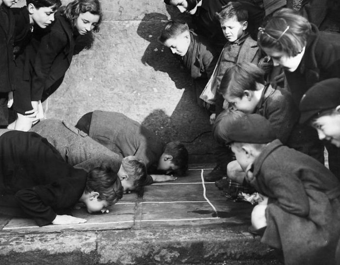 "Children Playing ""Push The Peanut"", King's Cross Street London, 1938"