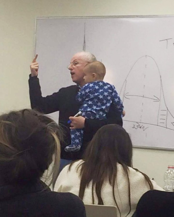 A University Student Brought Her Baby To Class Because She Couldn't Afford To Leave Him With A Nanny. When He Started Crying, Her Professor Scooped Him Up In His Arms And Calmed Him Down, All The Time Without Breaking Off His Lecture