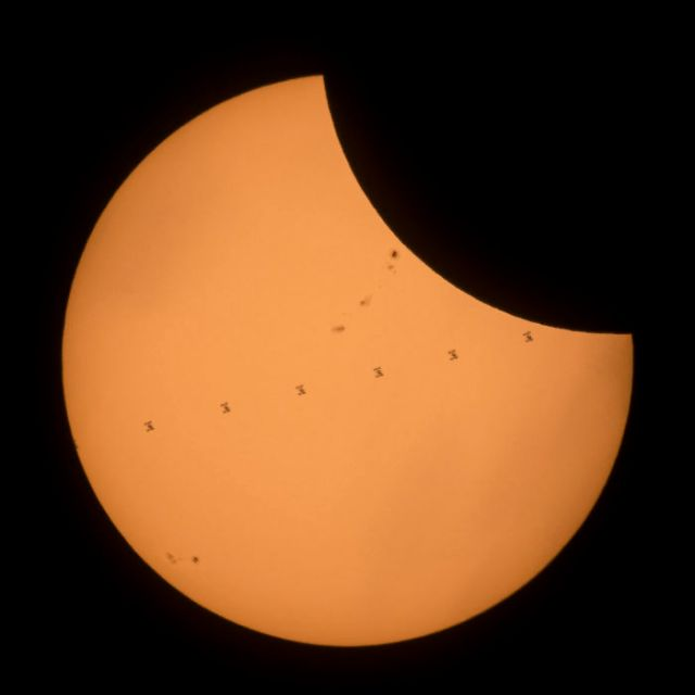 Total Solar Eclipse Photobombed By ISS Transit