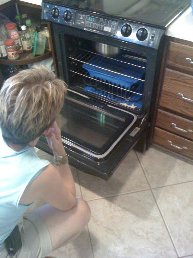 Pizza You Say? Here's My Mother-In-Law Preheating A Cutting Board