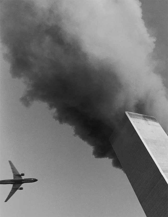 At Rector Street And Broadway, A Photographer Leaned Out His Window With A Medium-format Camera And Caught The Moment Before The Second Plane's Impact