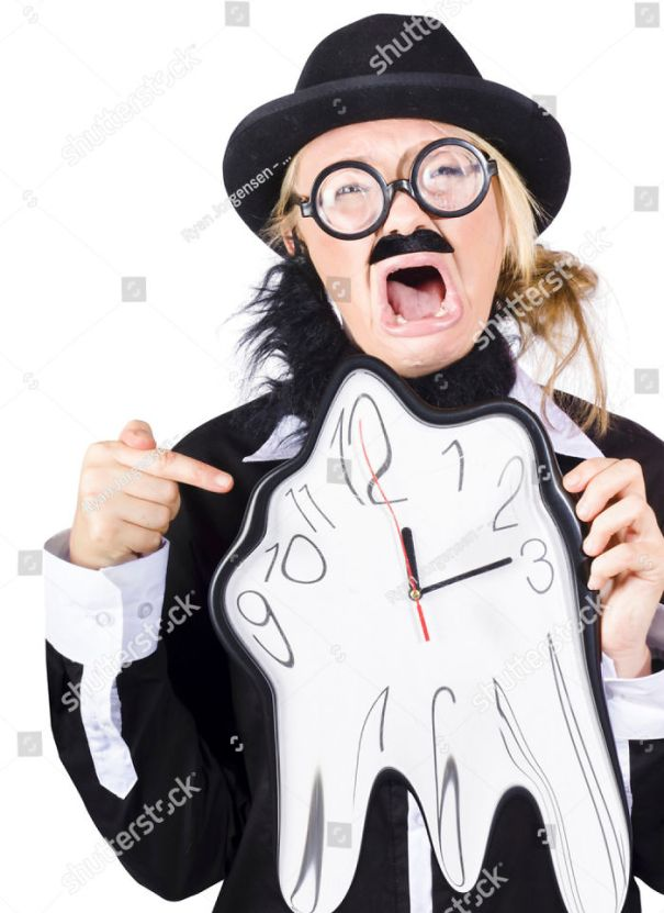 No Really, Wtf. Woman Dressed As Bearded Charlie Chaplain Points At Melting Clock With A Terrified Face.