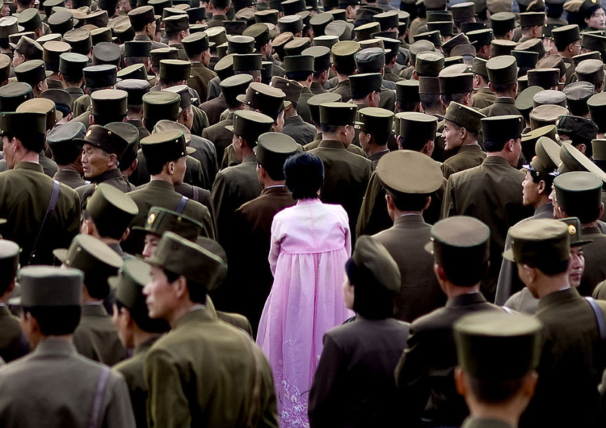 A Woman Standing In The Middle Of A Crowd Of Soldiers. This Picture Is Not Supposed To Be Taken As Officials Do Not Allow Army Pictures
