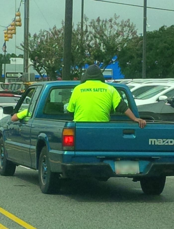 This Guys Shirt While Riding In A Truck Bed