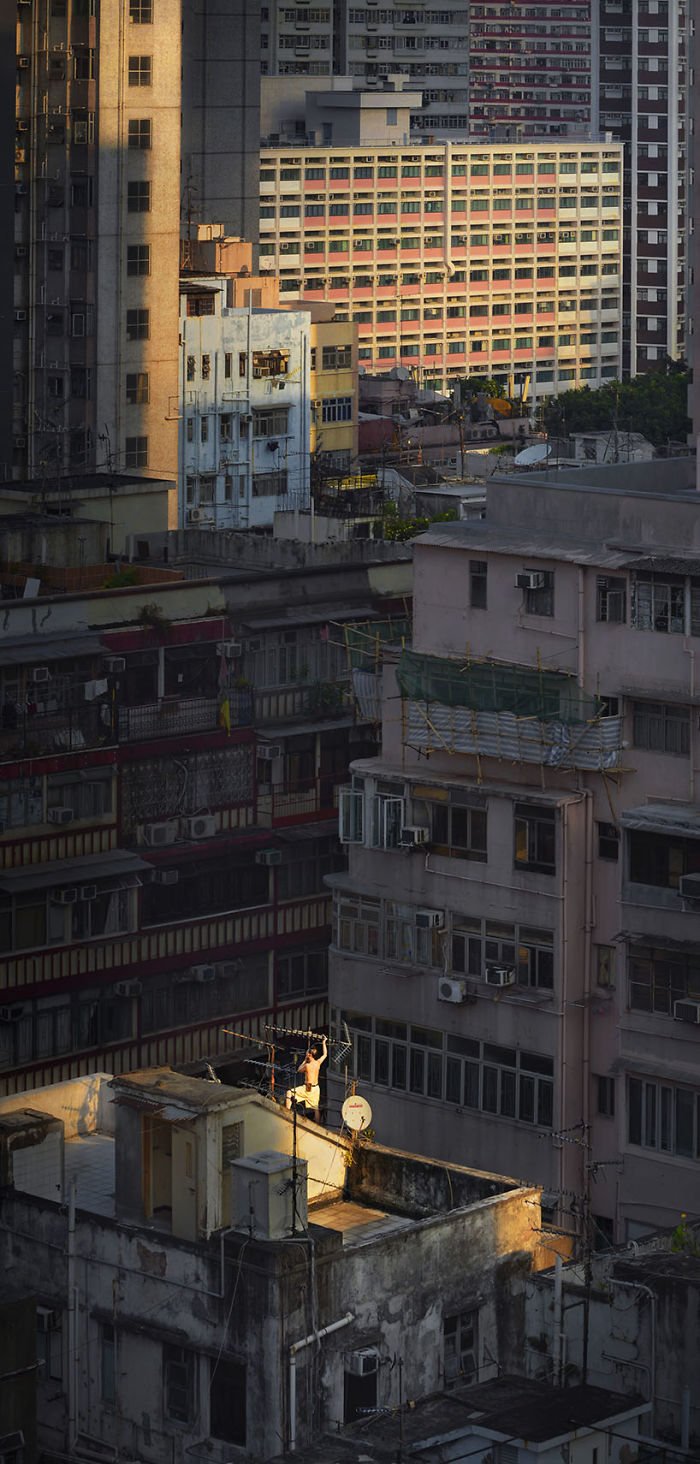 """""""Morning Fix,"""" A Man Is Fixing Up The Rooftop's Antenna At Dawn"""