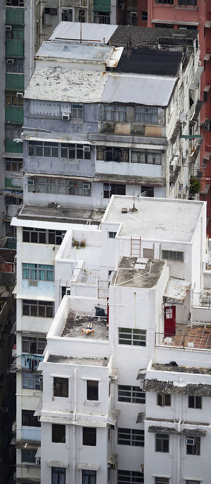 """""""Pushing Up,"""" A Man Is Doing Some Physical Exercise On The Rooftop"""