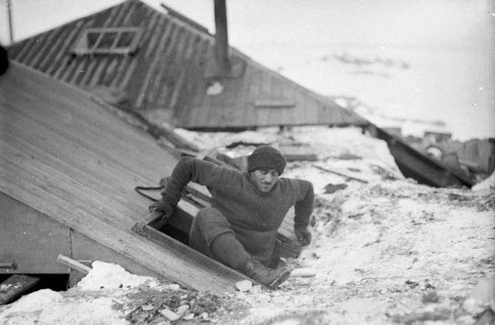 Mertz Leaving The Hut By The Trapdoor On The Verandah Roof