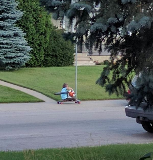 This Kid On A Longboard Using A Leaf Blower To Go Fast Is Now My Personal Hero