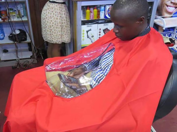 Haircut And Phone At The Same Time. We're Living In 2018 And This Guy Is Living In 3018