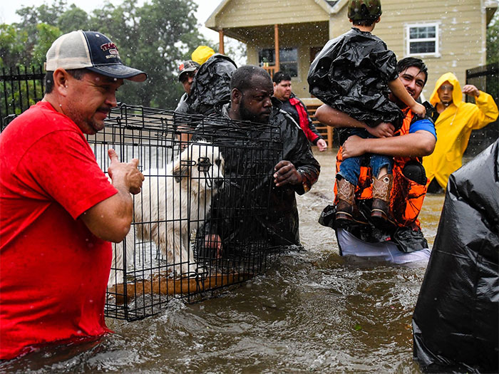 Volunteers Helping Flood Victims Evacuate In Houston