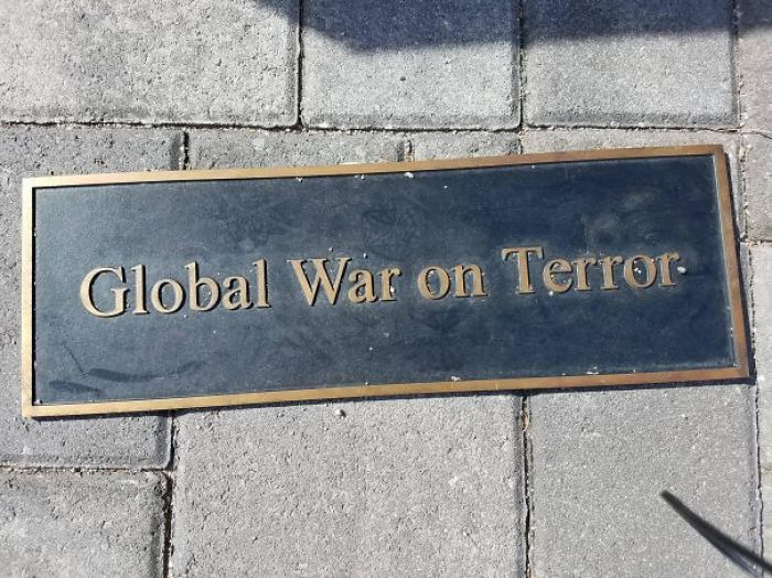 The Way This Plaque Was Set In Front Of A War Memorial