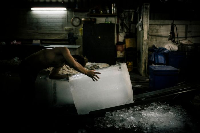 A Burmese Migrant Working Illegally In Saphan Pla Fish Market In Bangkok. He Sells Ice Blocks To Shrimp Packers