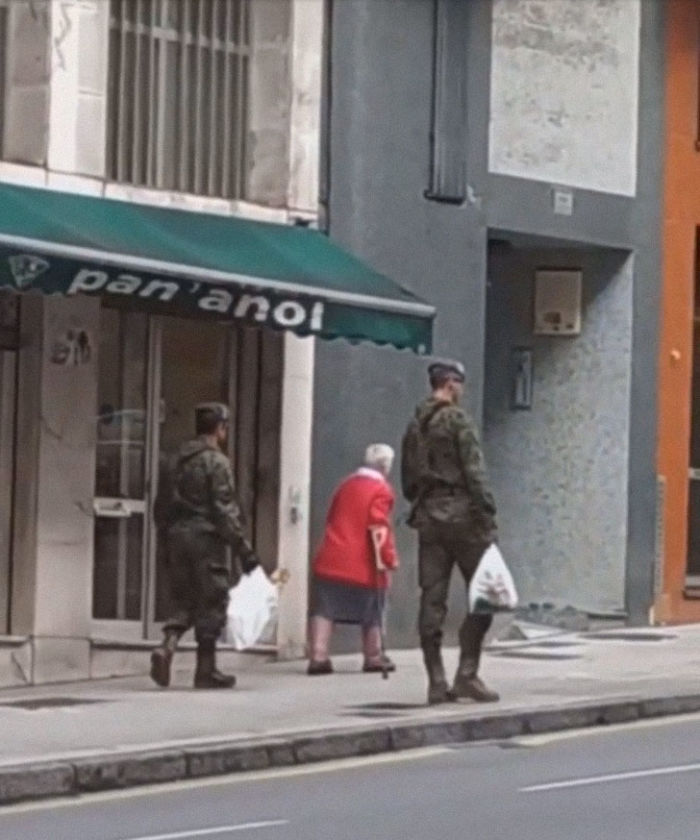Spanish Soldiers Helping An Elderly Woman During Quarentine