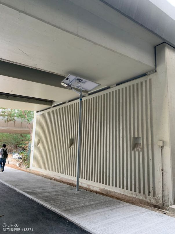 A Solar-Powered Streetlight Under A Bridge In Hong Kong