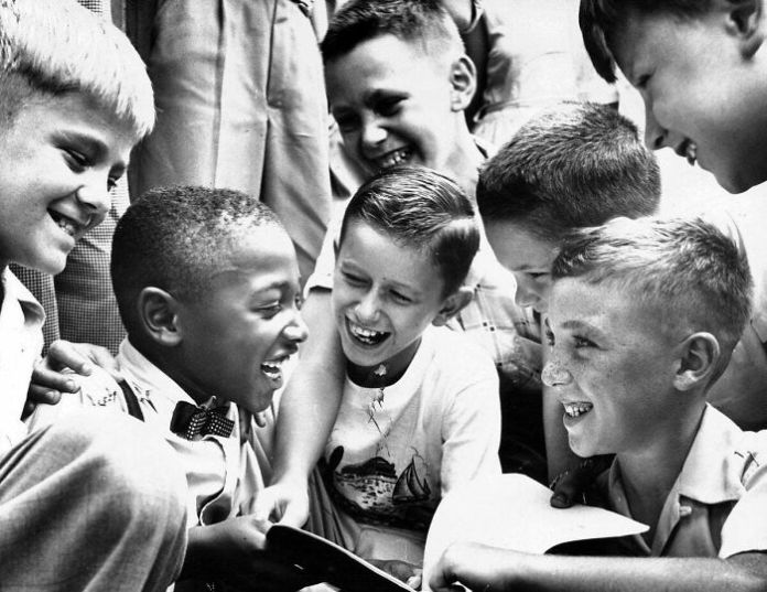 Charles Thompson Greets His New Classmates At Public School No. 27 In September 1954, Less Than Four Months After The Supreme Court Ruled That Racial Segregation Was Unconstitutional. Charles Was The Only African-American Child In The School. Photo By Richard Stacks For The Baltimore Sun